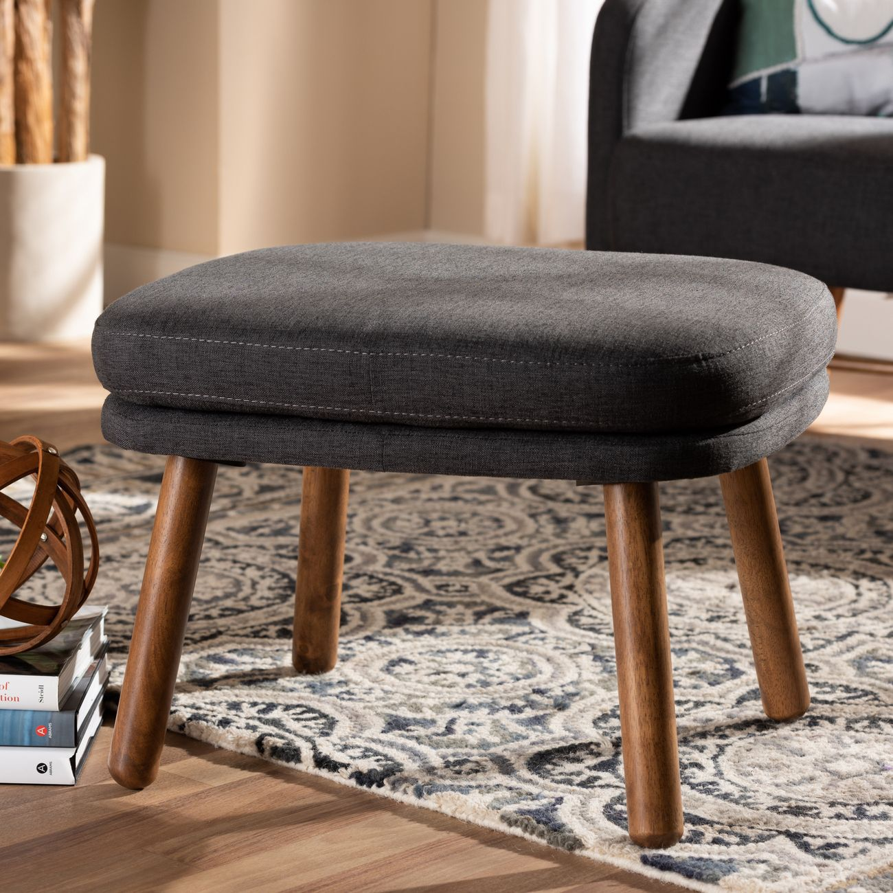 baxton studio lovise mid century modern dark grey fabric upholstered walnut brown finished wood ottoman bbt5342 dark grey